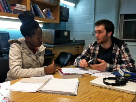 Biology TF Stephen Mugel works with a student during his hours.
