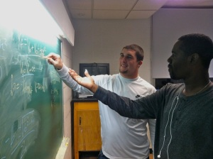 New Lead TF Michael Green helps a student during his Physics TF hours.